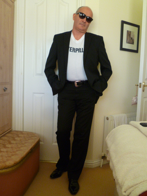 mature male escort fun50geeze in suit and shades